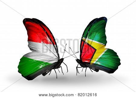 Two Butterflies With Flags On Wings As Symbol Of Relations Hungary And Guyana