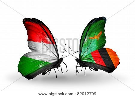 Two Butterflies With Flags On Wings As Symbol Of Relations Hungary And Zambia