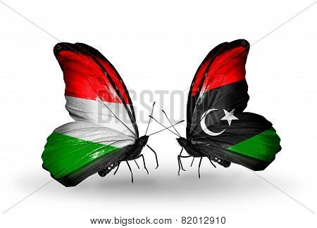 Two Butterflies With Flags On Wings As Symbol Of Relations Hungary And Libya