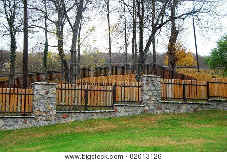Stone And Wooden Fence
