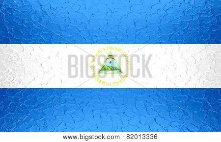 Nicaragua flag on metallic metal texture