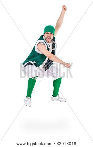 friendly man dressed like a funny gnome jumping Isolated on white