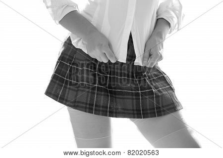 Black And White Photo Of Sexy Woman In Short Checkered Skirt