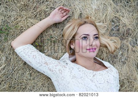 Beautiful young woman in the hay