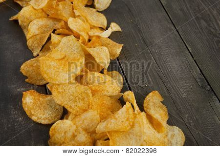 Potato Chips On A Wooden Background