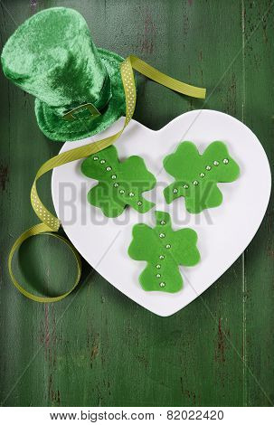 Happy St Patricks Day Shamrock Shape Green Fondant Cookies On White Heart Shape Plate On Vintage Sty