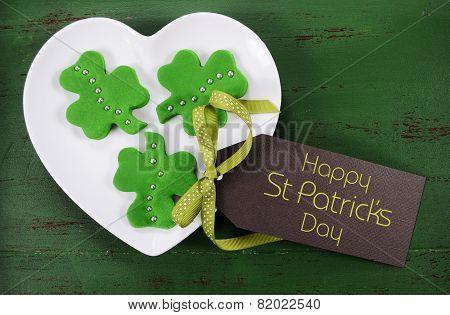 Happy St Patricks Day Shamrock Shape Green Fondant Cookies On White Heart Shape Plate On Vintage Sty