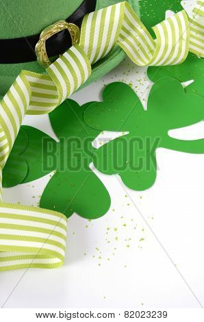 Happy St Patricks Day Leprechaun Hat With Shamrocks And Party Ribbons On White Table.