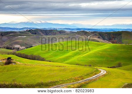 Tuscany, Winter Rural Landscape. Countryside Farm, White Road And Mountain On Background.