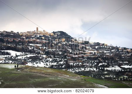Tuscany, Volterra Village Covered By Snow In Winter. Italy