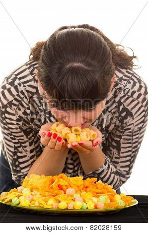 young girl overeating junk food