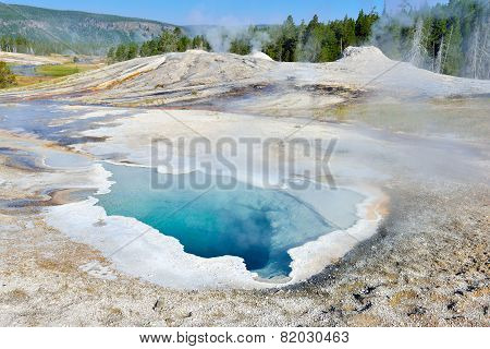Heart Spring Steaming Geyser In Upper Geyser Basin Of Yellowstone National Park, Wyoming