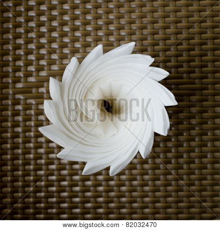 Glass With Tissues On Rattan Background.