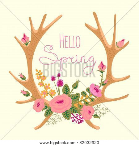Vintage card with deer antlers and flowers.