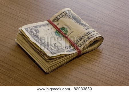 Bundle Of Dollar Notes On Table