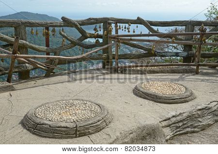Phuket, Thailand-Sept,23 2014: Wooden fence with Buddhist bells and top view of the coast of Phuket,