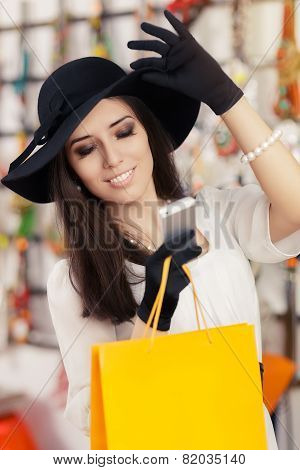 Happy Beautiful Woman with Smartphone at Shopping