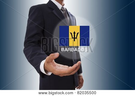 Businessman hand showing Barbados Flag