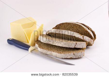 Sliced Brown Loaf of Bread Knife and Cheese Slices