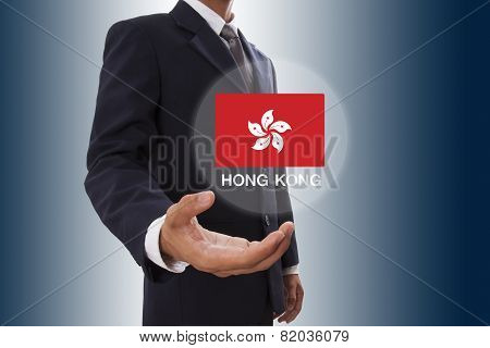 Businessman hand showing Hong Kong Flag