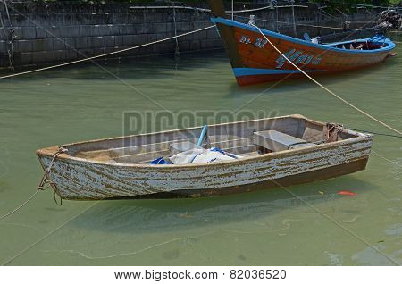 Phuket,TH-Sept,27 2014:Thai wooden boats on the canal on Kata Beach