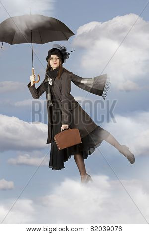 Young woman Flies On An Umbrella