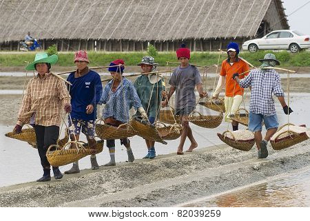 People work at the salt farm in Huahin, Thailand.