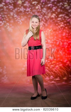 Young girl in red dress pose in studio