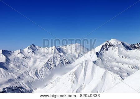Snowy Mountains In Sun Day
