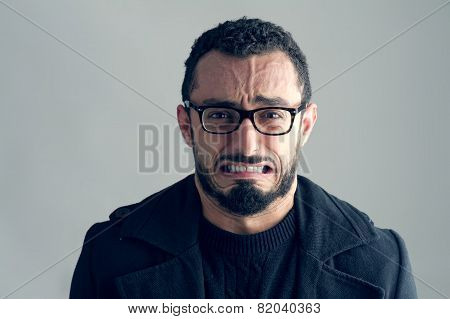 Man with Frustrated Expression isolated on grey background