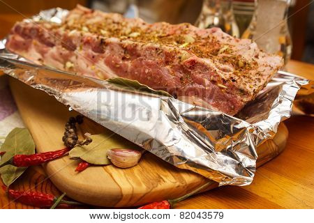 Fresh Pork Ribs, Meat Marinated And Prepared For Roast With Garlic In A Foil