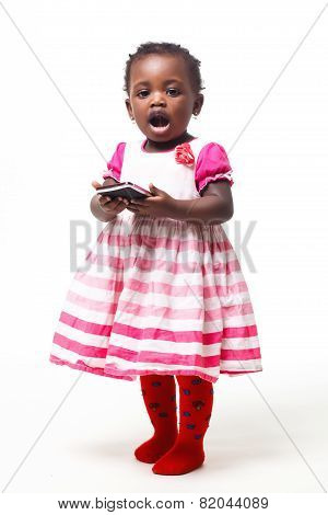 Happy child holding a mobile phone isolated over white