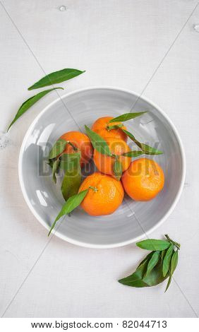 Tangerines With Green Leaves On White Wooden Background
