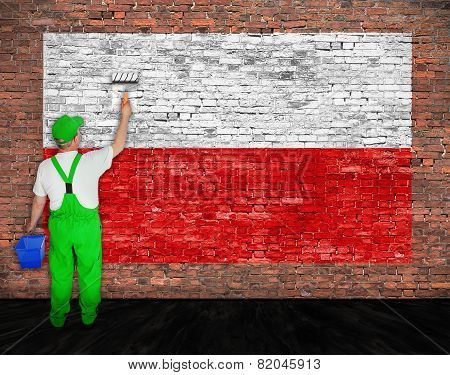 House Painter Paints Flag Of Poland On Brick Wall