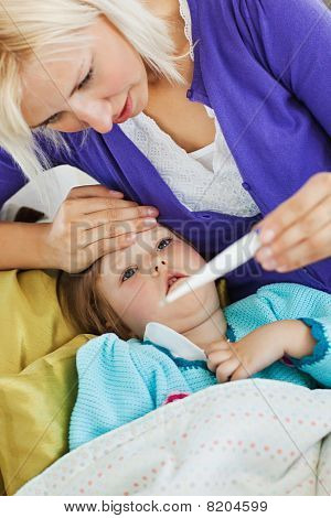 Sick Female Child Lying On Couch