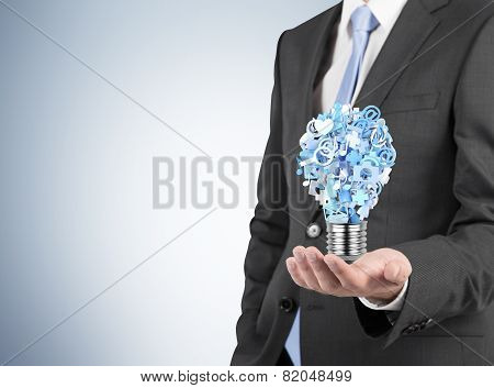 Businessman Holding  Bulb