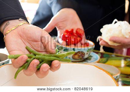genuine vegetables inside chef hands