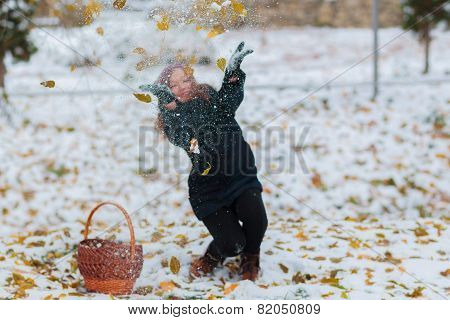 Happy Girl With Gloves Playing With Snow And Jump In The Winter Landscape. Girl Playing With Snow In