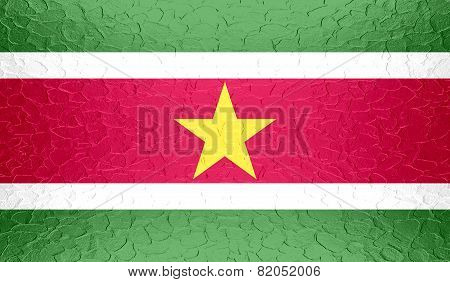 Suriname flag on metallic metal texture
