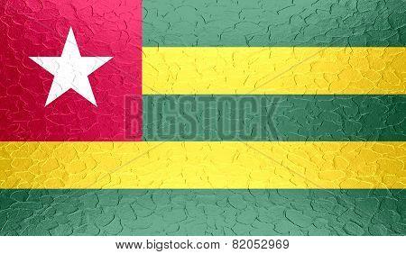 Togo flag on metallic metal texture