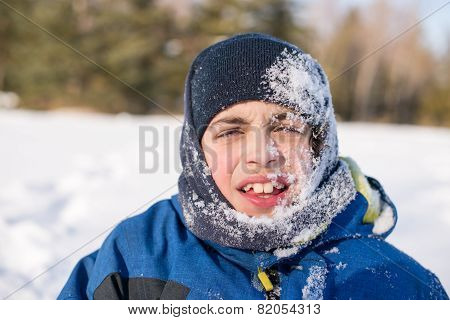 Child Boy Playing And Having Fun In White Fresh Snow