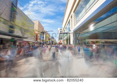 People walking along a shopping street in Adelaide, South Australia