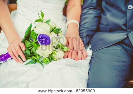 Bride And Groom Holding Hands.