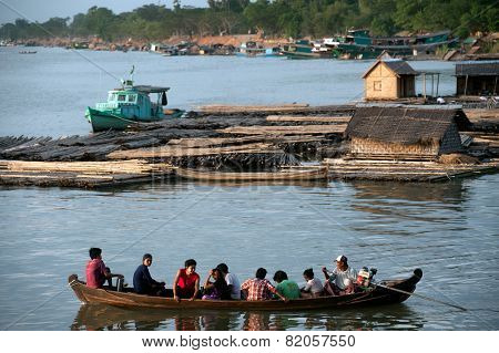 Villagers Ride Across The River.