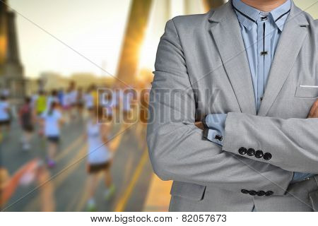 Business Man Sport Manager And Executive With Background Of Marathon Race