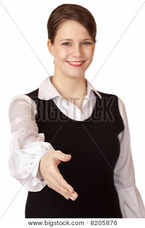 Beautiful businesswoman gives hand for handshake.
