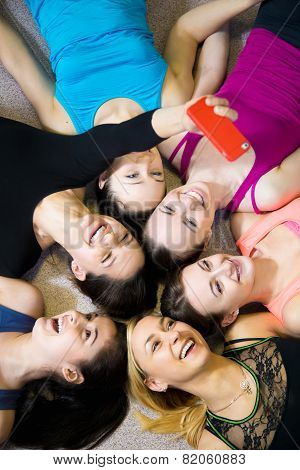 Group Of Happy Sporty Girlfriends Taking Selfie, Self-portrait With Smartphone View From Top