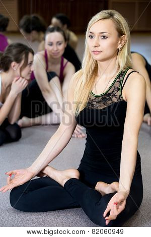 Yogi Girl Exercising, Doing Yoga Pose Sukhasana