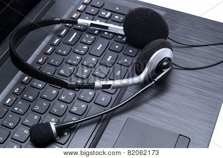 Headset Lying On A Laptop Computer Keyboard