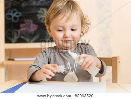 Little Boy Studies Glue